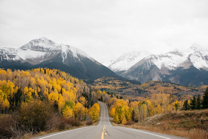 Road leading to fall mountain scene